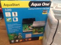 Aqua One fish tank with box,white and blue light,water filter,28 litres,good condition no leak