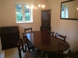 Dining table and chairs, display unit, bureau and mirror all matching dark oak, buyer collects.