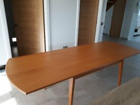 Extending Dinning Table in good condition in light wood