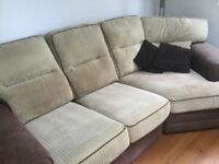 Large clean brown and cream sofa. 7 soft cord cushions, suede effect base and arms.