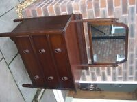 A vintage three drawer dressing table with mirror.