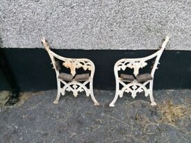 Two cast iron bench ends
