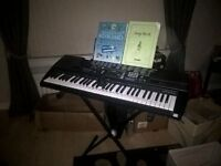 Casio Keyboard with stand, power adaptor, manual and instruction books