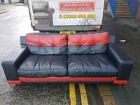 Dfs red and black leather 3 seater sofa on chrome feet