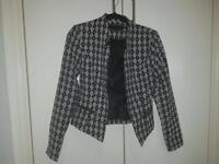 Black and white jacket.
