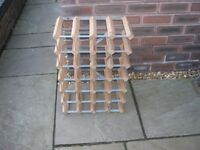 A 24 bottle wood and metal wine rack.