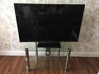 "42"" Panasonic TV and glass stand"