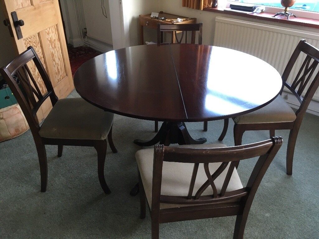 Polished round extendable dining table and chairs FREE ...