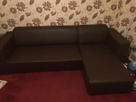 Brown leather corner settee
