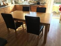 Large wooden kitchen table and chairs.
