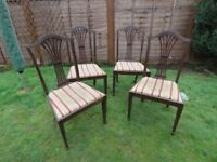 Four Chippendale Edwardian Mahogany numbered chairs