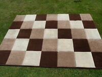 Chequered rug in browns and creams - 18 months old 2.1 m x 1.45m