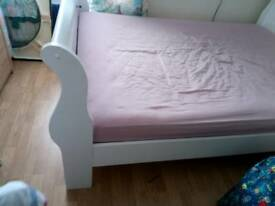 Double white wooden bed