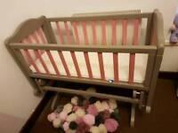 Pink and Grey Mama's and Papa's gliding crib