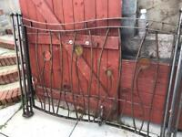 Metal panel fence with posts.