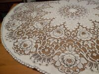 Circular crotchet effect tablecloth & two wicker placemats