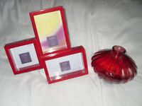 red next vase and picture frame