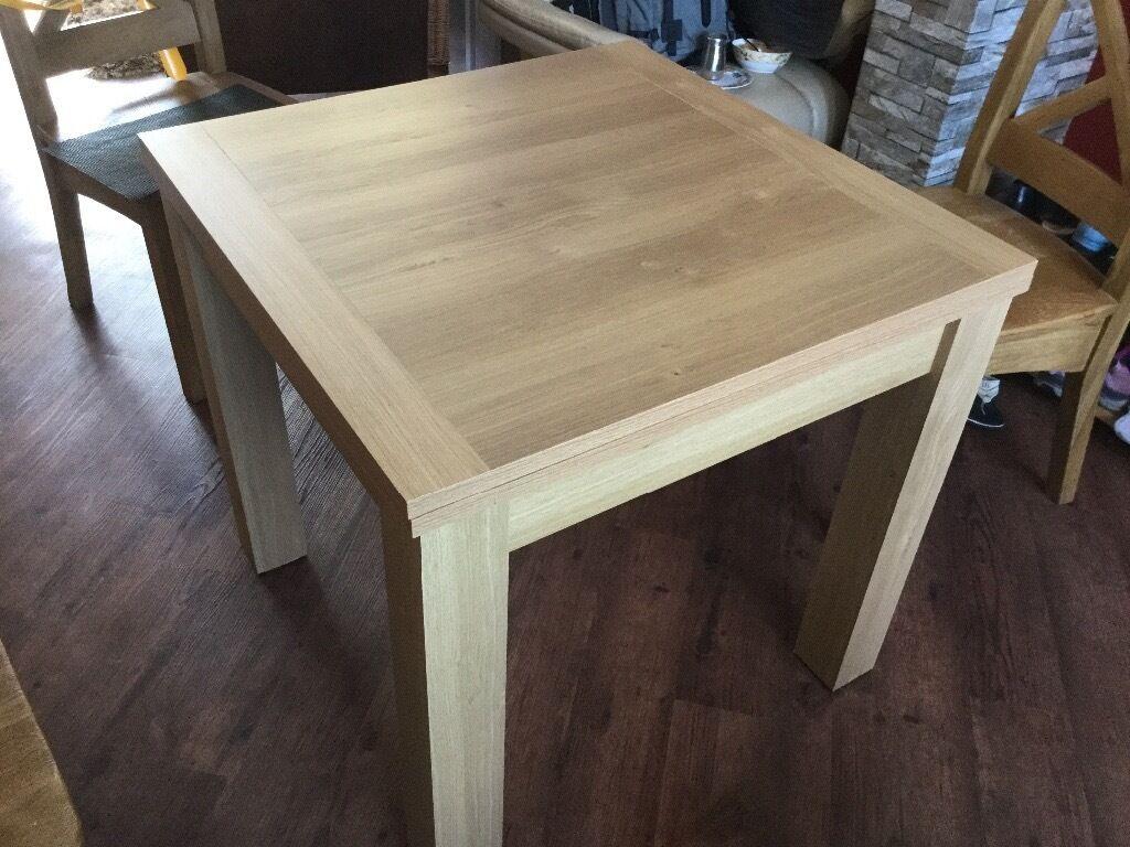 Next Malvern oak veneer extending dining table