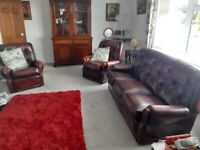 Leather 3 seater sofa and 2 armchairs.
