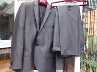 Moss Bros Grey suit.