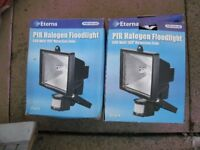 Two security flood lights still in the box. Eterna PIR Halogen floodlights 500 watts