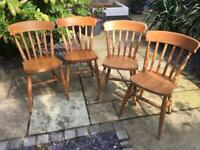 Four solid pine dining chairs