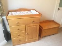 Wooden changing table with storage and toy box.