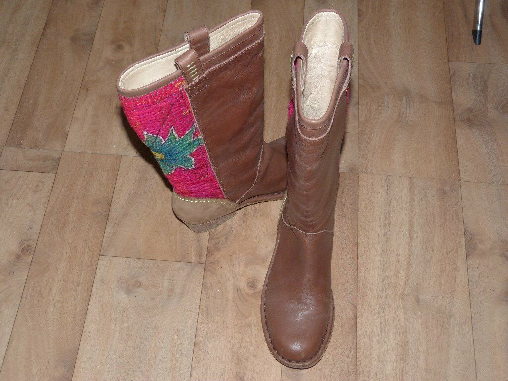 Size 6, Ladies tan leather boots with attractive stitching.