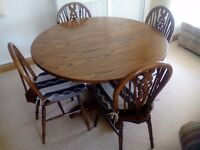 Dining room table in good condition light oak with four matching chairs.Also matching welsh dresser.