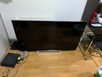 62in SONY FLAT SCREEN TV I PERFECT CONDITION. with stand and remote control