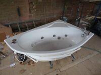 Corner whirlpool bath with Bristan taps (£40 ONO)