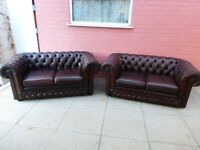 A Pair Of Thomas Lloyd Brown Leather Chesterfield Two Seater Settees