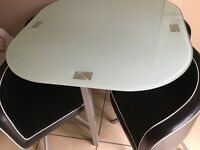 Table with four chairs fitting under table . Can deliver within Ayrshire area