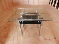 Glass table with under storage for sale