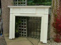 A large painted antique pine and gesso fire surround