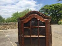 Antique wooden shelved cabinet with lock and key
