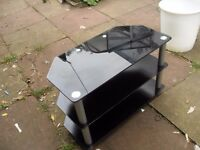 VERY NICE TV STAND DARK GLASS WITH 3 SHELVES CAN DELIVER