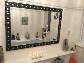 Stunning black glass mirror