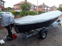Kruger Alfa 4.4m boat and trailer with9.8 hp Tohatsu electric start engine 20 hours use