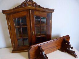 Mahogany reproduction medicine cabinet and matching shelf.