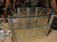 John Lews Metal and Glass TV and entertainment system stand. Good heavy quality