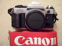 Canon AE 1 program 35mm SLR camera, 3 lenses, Canon 199A flash and accessories