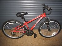 CHILDS APOLL XC24. FRONT SUSPENSION BIKE IN EXCELLENT USED CONDITION.. (SUIT APPROX. AGE. 8 / 9+)..