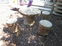 garden stone table and 3 stools made to look like wood for children