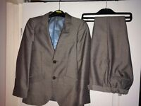 Lovely grey boys suit. Age 7-8. Only worn once!!