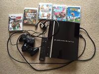 Piano Black 80GB Playstation 3 (PS3), 5 Games, 2 Controllers