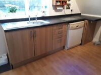 Kitchen fittings work surfaces, cabinets,cooker and hob, sink, extractor and splash back