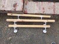 Three wooden hand rails