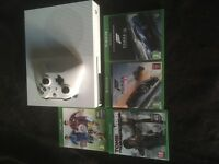 Xbox one s with control and 4 games . Console still have warranty for 9 months from shop cex