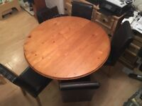 Pine extendable dining table round